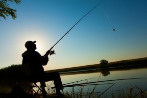 man-fishing-on-a-lake_1004-12
